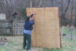 moving_fence_panels_doing_a_lawn_care_job_in_china_grove_nc